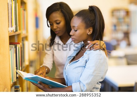 pretty african university students friends studying in library - stock photo