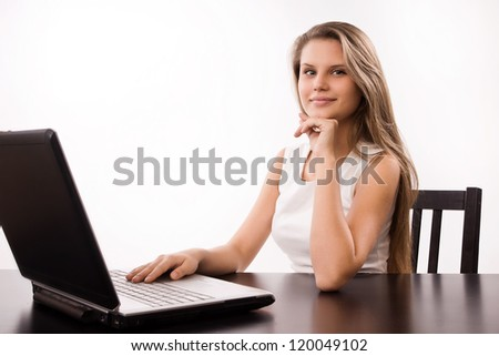 Pretty and confident girl  in a office - stock photo