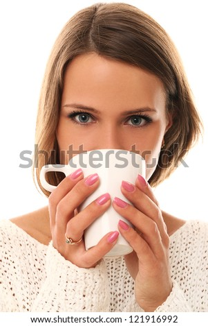 Pretty and young woman drinking tea isolated on a white - stock photo