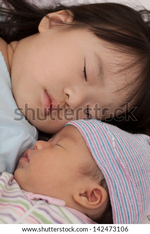 Pretty asian baby girls sleeping - stock photo