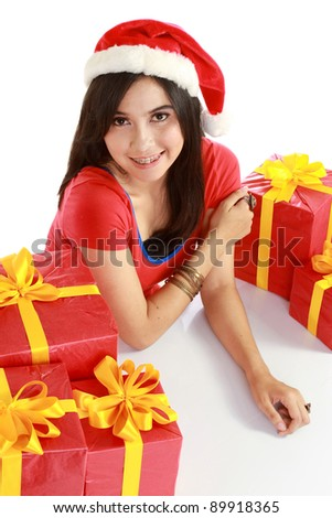 pretty asian girl in santa hat with her xmas gifts isolated on white background - stock photo