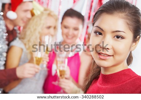 Pretty Asian girl looking at camera with smile - stock photo