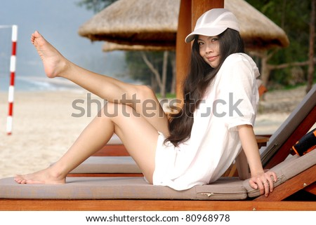 pretty asian girl relaxing at the beach - stock photo