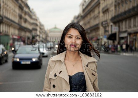pretty asian girl walking in the streets of paris - stock photo
