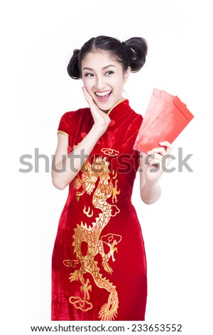 Pretty Asian girl with Chinese traditional dress cheongsam or qipao holding ang pow or red packet monetary gift. Chinese new year concept, female model isolated on white background. - stock photo