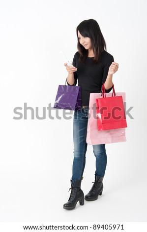 pretty asian woman in shopping - stock photo