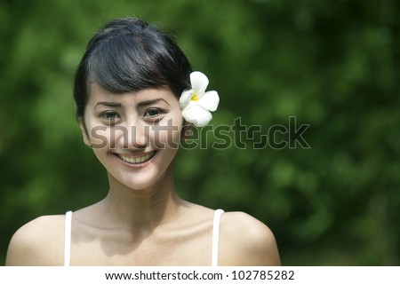 Pretty Asian woman with beautiful teeth smiling - stock photo