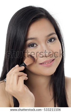 Pretty asian women closeup head shot putting on makeup