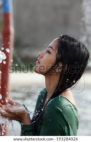 pretty asian young woman shower outdoor - stock photo
