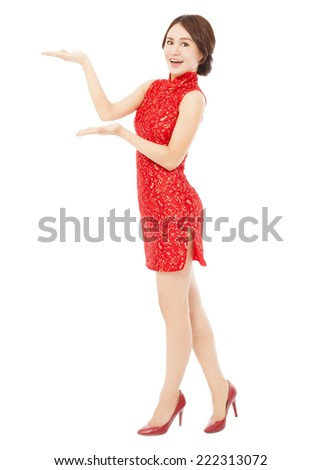 pretty asian young woman with cheongsam standing. isolated on white background - stock photo