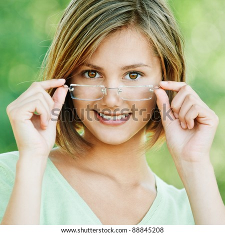 pretty attractive woman short hair wearing glasses walking park - stock photo