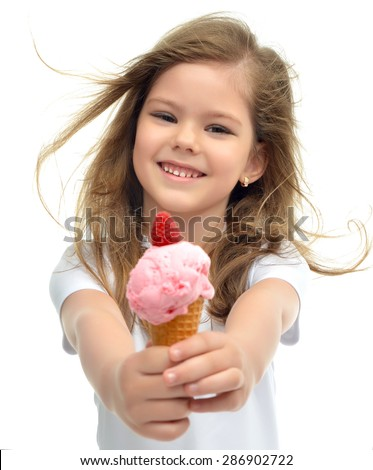 Pretty baby girl kid holding ice cream in waffles cone with raspberry showing happy smiling isolated on a white background - stock photo