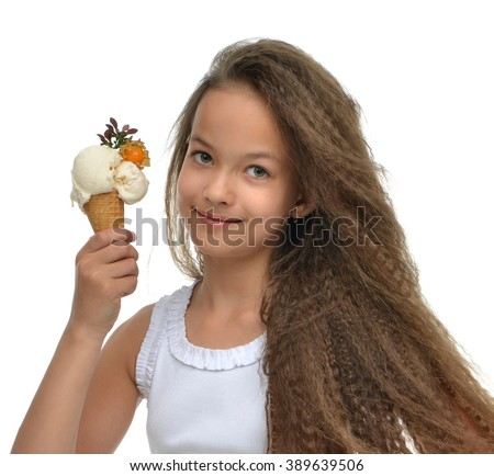 Pretty baby girl kid holding vanila ice cream in waffles cone smiling looking at the corner isolated on a white background - stock photo