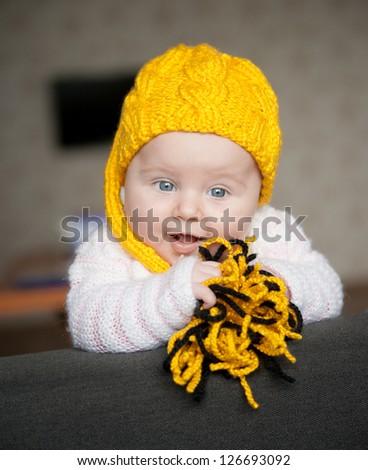 pretty baby of tender years in yellow hat - stock photo