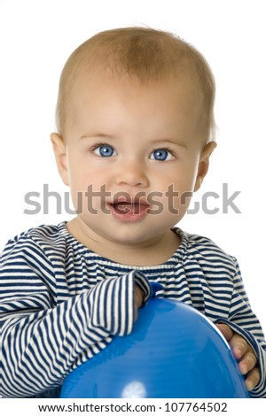 Pretty baby with balloon - stock photo