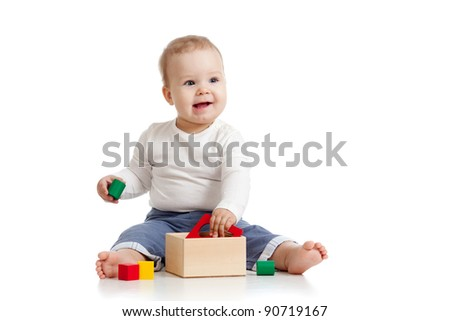 pretty baby with color educational toy - stock photo