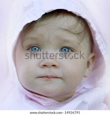 pretty baby with wise face and water transparent deep blue eyes - stock photo