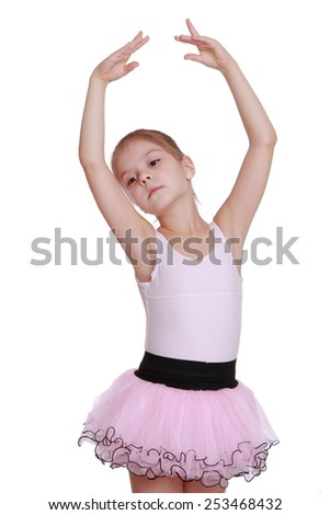 Pretty ballerina dancer wears a pink dress on a white background - stock photo