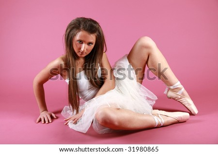 Pretty ballet girl on pink - stock photo