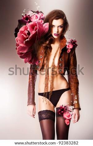 pretty beautiful erotic flower woman in panties and brown jacket - stock photo