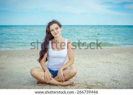 pretty beautiful  woman  posing in summer near the sea  with gorgeous smile in happy mood