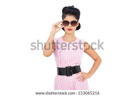 Pretty black hair model wearing sunglasses on white background - stock photo