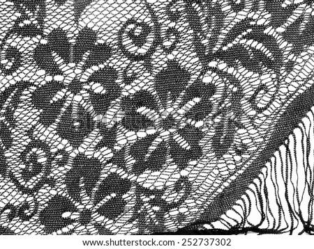 Pretty black lace shawl detail. - stock photo