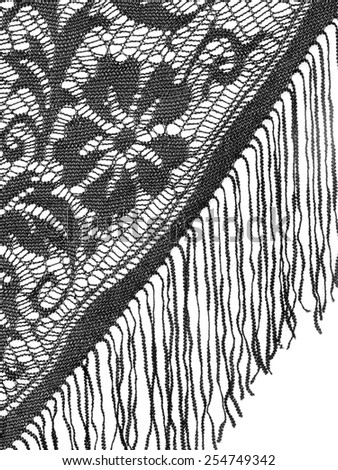 Pretty black shawl detail with fringe, over white. Vertical. - stock photo