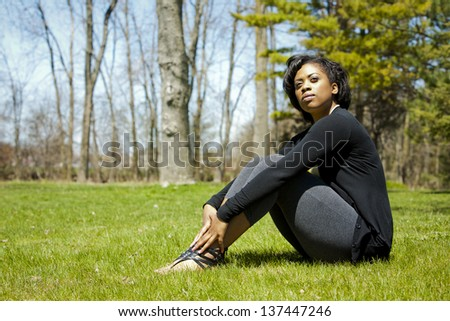 pretty black woman enjoying summer in the park - stock photo