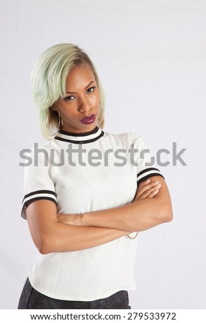 Pretty black woman with a thoughtful look and arms crossed