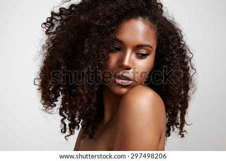 pretty black young woman with afro hair - stock photo