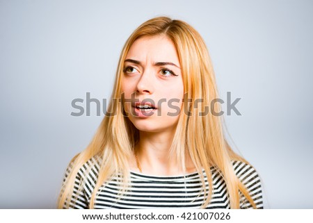 Pretty blond girl angry and indignant isolated on white background - stock photo