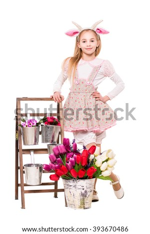 Pretty blond girl dressed like a goat posing near flowers. Isolated on white - stock photo