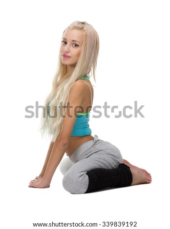 Pretty blond girl in her knees, isolated on white - stock photo
