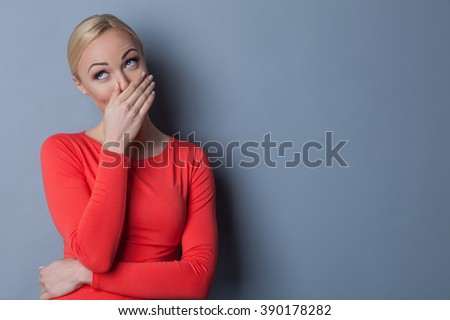 Pretty blond girl is baiting someone - stock photo