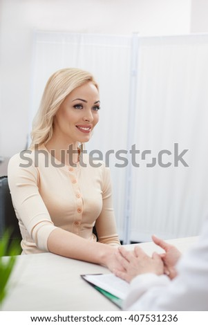 Pretty blond girl is consulting general practitioner - stock photo
