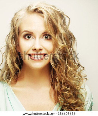 pretty blond girl smiling and laughing