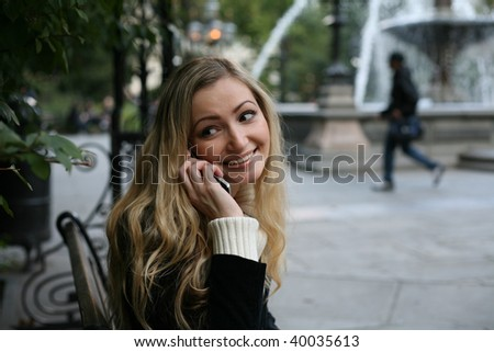 pretty blond girl talking on the phone - stock photo