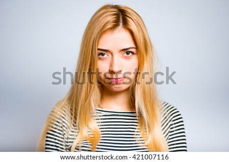 Pretty blond girl was offended and feel angry isolated on white background - stock photo