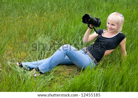 pretty blond girl with photo camera