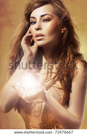 Pretty blond lady showing your shining object, empty hand with copy-space - stock photo