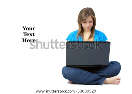 Pretty blond teen with a laptop computer