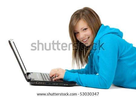 Pretty blond teen with a laptop computer - stock photo