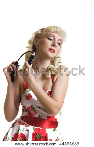 Pretty blond with perfume bottle in style of fifties - studio shot - stock photo