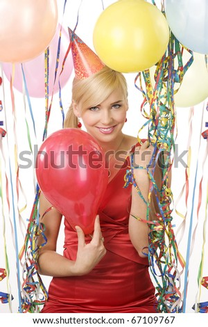 pretty blond woman in red dress with balloons during a party over white looking in camera smiling