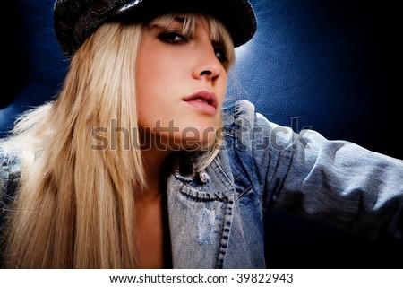 pretty blond woman portrait wearing cap - stock photo