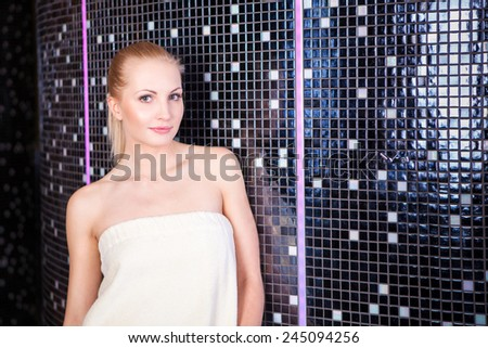 Pretty blond woman resting in a spa and wellness resort - stock photo