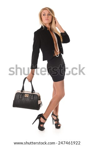Pretty Blonde Fashion Girl with long legs holding a handbag - stock photo