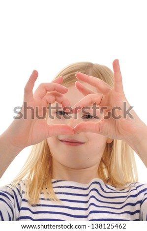 pretty blonde girl making the shape of a heart with her hands, isolated on white background