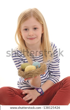 pretty blonde girl with basket of Easter eggs isolated on white background